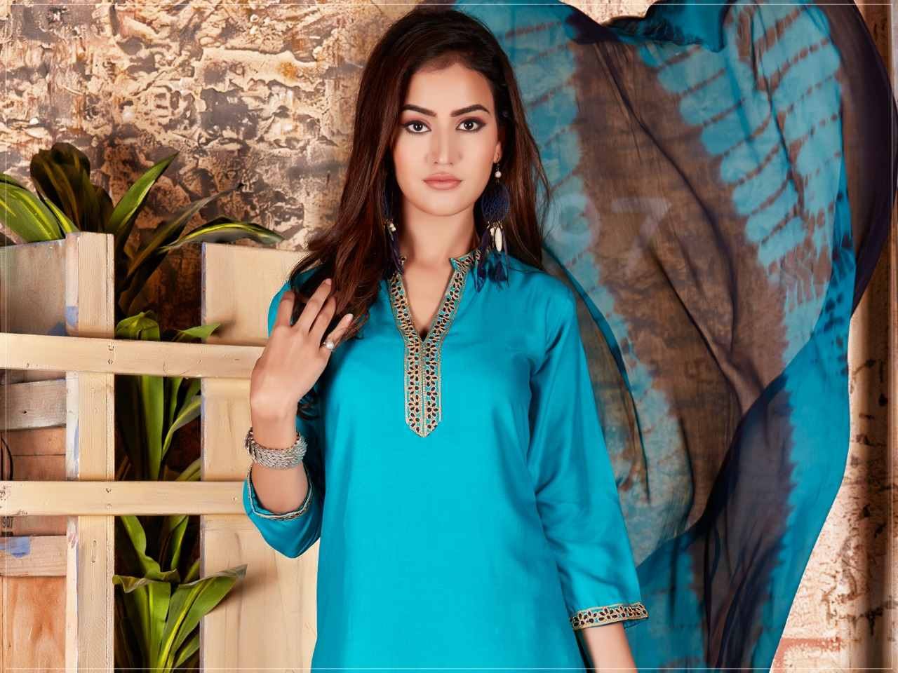The Ethnic Studio Baby Doll Designer Embroidery Work With Rayon Stitch Kurties Wholesale